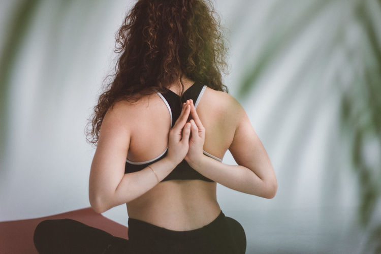Yoga Yoga Pose Yogagirl Yoga Practice Yoga ॐ Back Namaste One Person Lifestyles Women Hairstyle Real People Indoors  Hair Focus On Foreground Standing Leisure Activity Rear View Curly Hair Adult Young Women Human Body Part Hand Young Adult Brown Hair Waist Up Human Arm Human Hair Human Limb