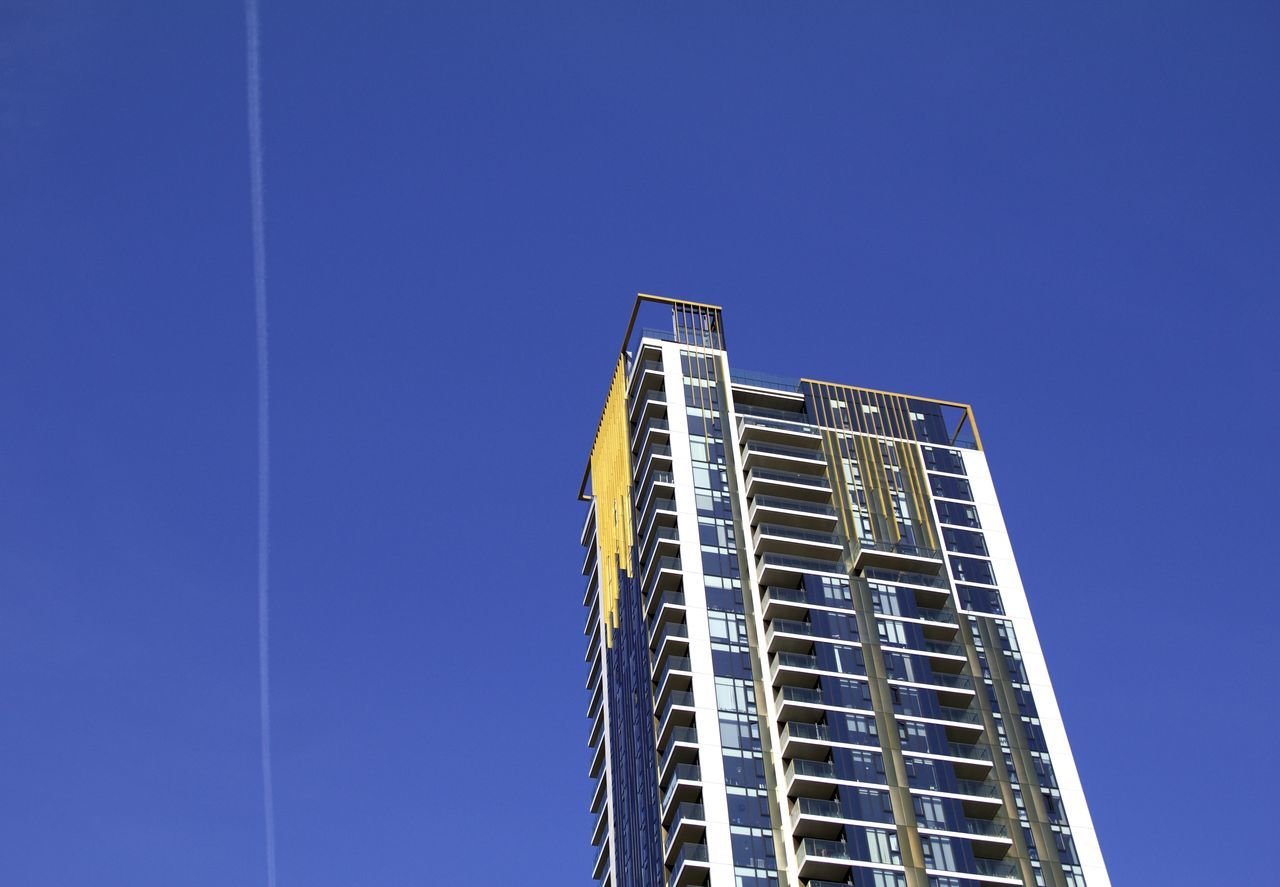 blue, copy space, low angle view, clear sky, day, architecture, no people, built structure, outdoors, building exterior, modern, sky