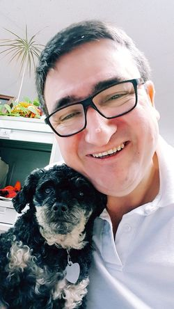 Pets One Animal Eyeglasses  Adult Dog Smiling Domestic Animals Looking At Camera Happiness Mammal Indoors  Cheerful Pooch Poodle Work Dog At Work Selfıe Me And My Dog Fun At Work Starting The Day Self Potrait Samsung Galaxy S7 Edge At The Office Happy Human, Tired Pooch