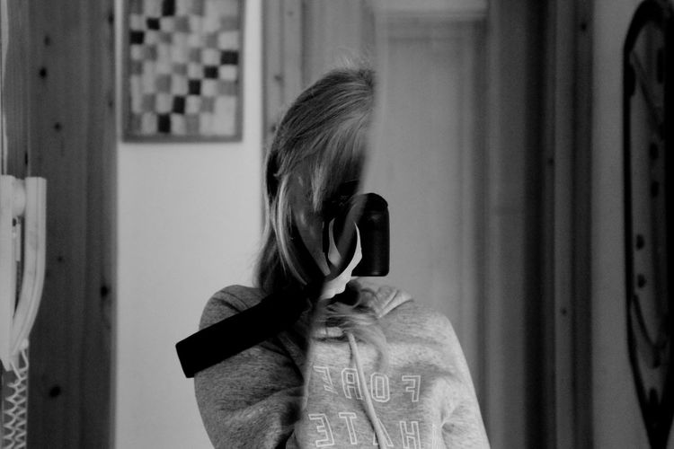 Reflection of woman on mirror at home
