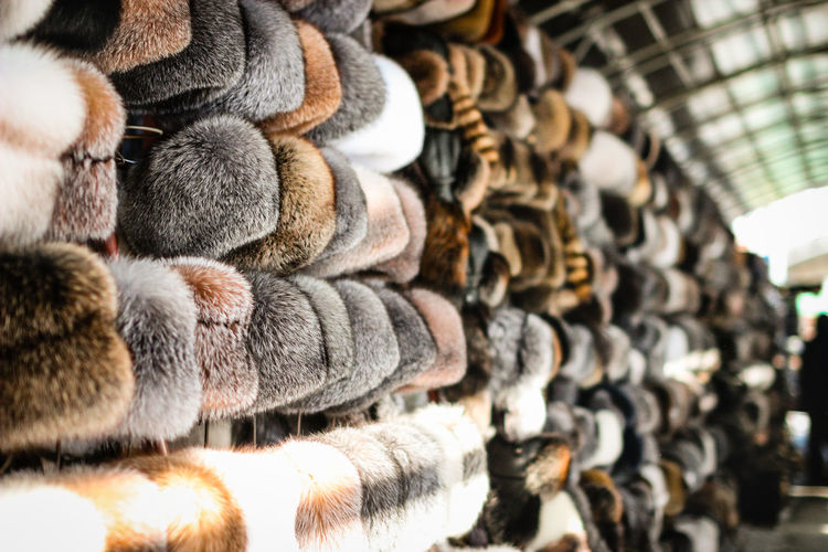 Fur hats hanging at market for sale
