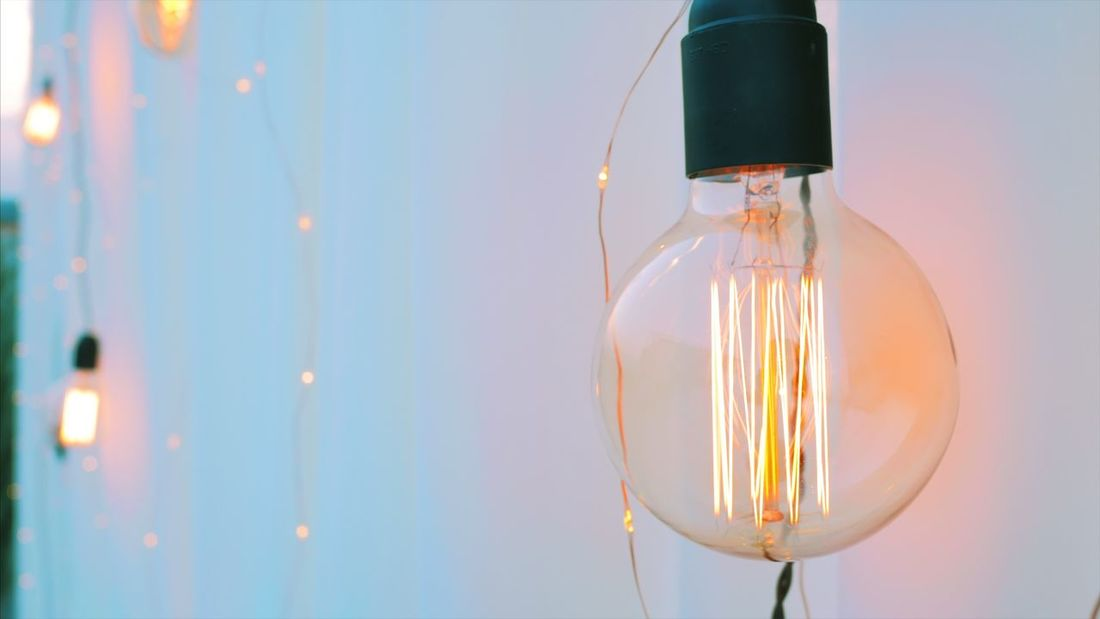 Lighting Equipment Illuminated Light Bulb Electricity  Electric Light Bulb Hanging Glowing Close-up Electric Lamp No People Filament Lamp Shade  Indoors  Focus On Foreground Fuel And Power Generation Technology Day Bulbs Edison Bulb Holiday