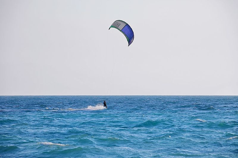 catch your wind and fly away Black Sea Paragliding Stunt Person Extreme Sports Water Sea Sport Flying Adventure Multi Colored Full Length Kiteboarding Windsurfing Kite - Toy Parachute Gliding Surfboard Skydiving Aerobatics Aquatic Sport Surfer Parasailing Surfing Water Sport Paddleboarding