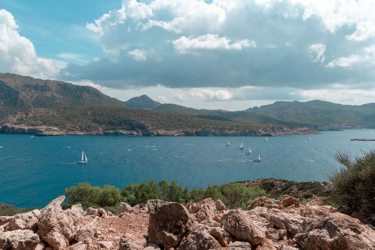 Sa Dragonera Water Mountain Beauty In Nature Scenics - Nature Cloud - Sky Sky Day Tranquility Nature Mountain Range Tranquil Scene Rock Sea No People Nautical Vessel Solid Non-urban Scene Transportation Outdoors Sailboat Bay Rocky Coastline Sailing Sant Elm Mallorca