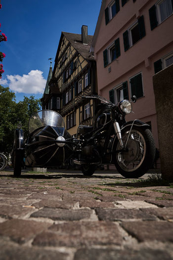 Old Motorcycle parked in Tübingen Architecture Building Building Exterior Built Structure City Day Land Vehicle Mode Of Transportation Motorcycle Nature No People Outdoors Parking Residential District Sky Street Surface Level Transportation
