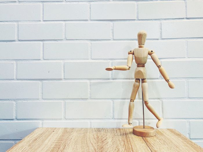 Wooden human figure on the wooden table Human Figure Model Copy Space Background Backgrounds Object Model School Supplies Educational Education White Wall White Figure White Brick Wooden Wooden Table Human Representation Representation Wall Brick Brick Wall Toy Wood - Material Wall Brick Wall Creativity