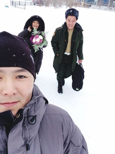 Winter Cold Temperature Snow Portrait Warm Clothing Looking At Camera Young Men