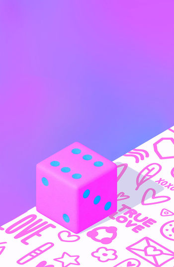 Close-up of pink toys against blue background