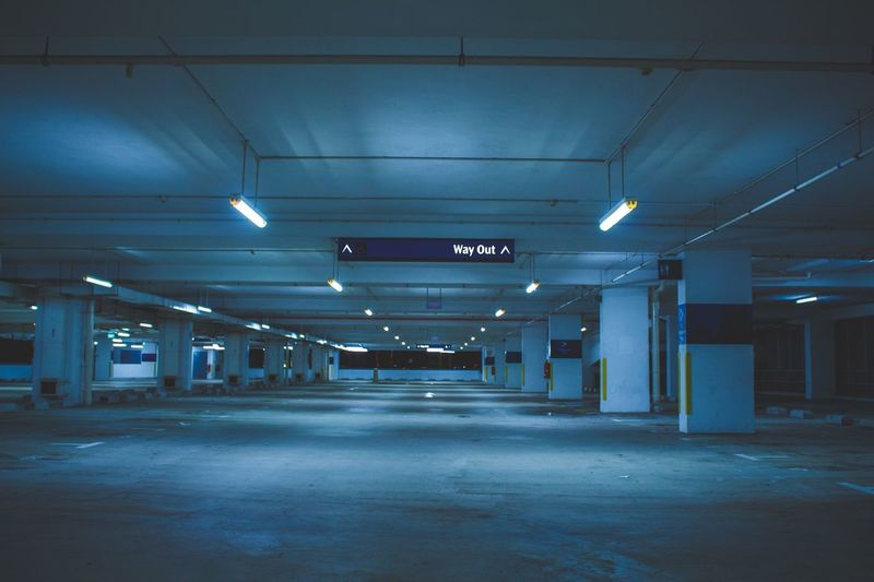 Illuminated Underground Parking Lot At Night