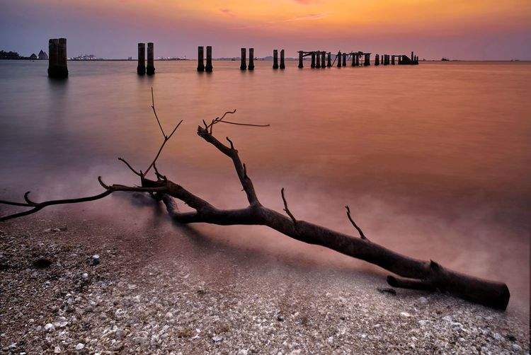 sunset Water Sea Sunset Beach Shipyard Red Business Finance And Industry Groyne Reflection Fishing