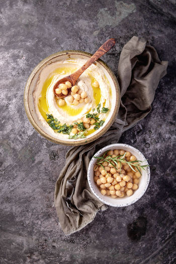 High angle view of hummus in bowl on table