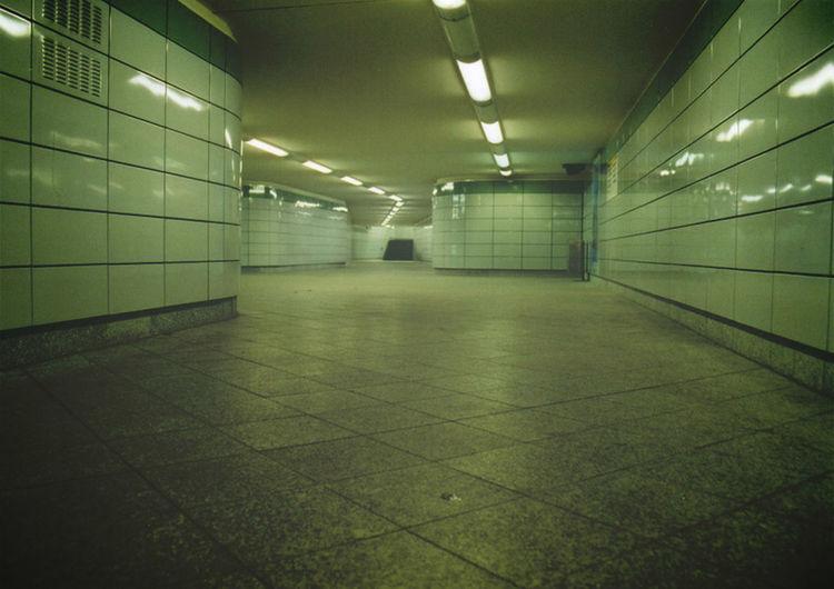 Narrow walkway along tiled floor