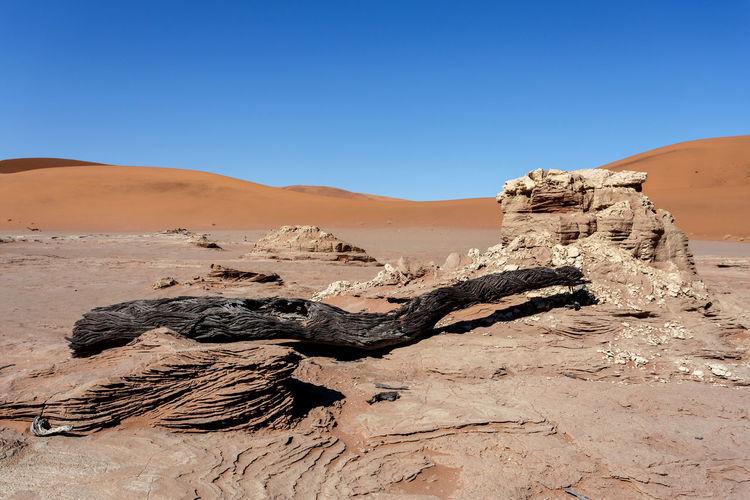 Shadow of man on sand dune