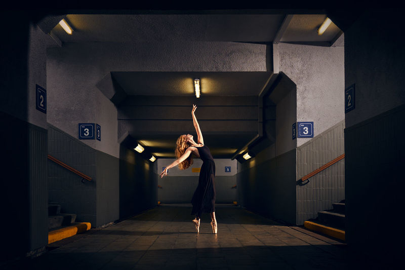 Dance your life #urbanana: The Urban Playground Dance Architecture Arms Raised Built Structure Dancers Full Length Human Arm Illuminated Indoors  Lifestyles One Person Public Transportation Real People Women
