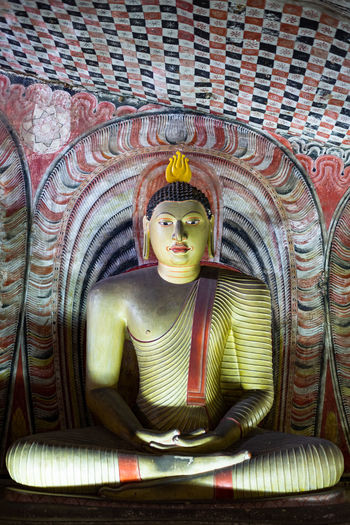 A Buddhist statue in a cave in Sri Lanka. Human Representation Representation Male Likeness Spirituality Religion Belief Art And Craft Sculpture Statue Creativity No People Place Of Worship Architecture Idol Building Built Structure Indoors  Ornate Mural Buddhism Buddhist Temple Colourful