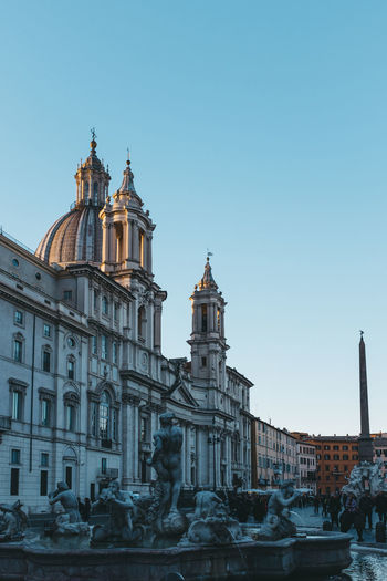 Low Angle View Of Cathedral At Piazza Navona Against Clear Sky