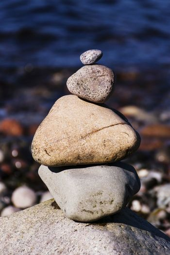 Close-Up Of Stones Stack At Beach