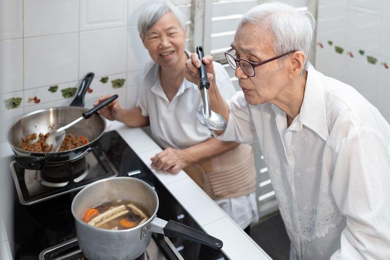 People having food in kitchen