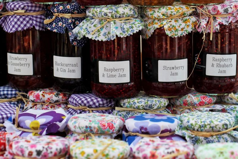 Rows of jars of jams and preserves with colourful lids and covers. Jam Preserves Jars  Craft Homemade Food Market Market Stall Crafts Jelly Berries Fruit Rows Rows Of Things Sweet Sugar
