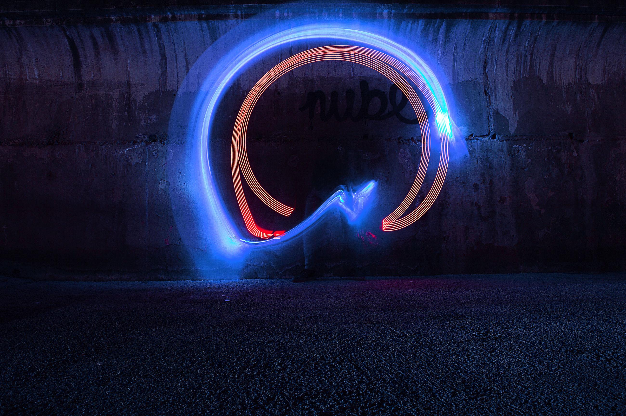 illuminated, long exposure, glowing, night, light painting, motion, light trail, circle, light - natural phenomenon, blurred motion, wire wool, speed, architecture, geometric shape, spinning, no people, creativity, city, shape, communication, light