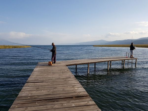 Water Pier People Sky Outdoors Standing Beauty In Nature Lake Ohrid Struga Fishing Two People Tranquility Lake Lakeside Angling