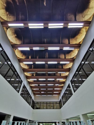 Low angle view of illuminated staircase in building