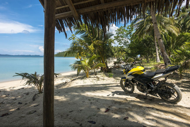 Motorcycle parked on a tropical white sand beach Beach Bliss Bohol Cebu Exotic Heaven On Earth Heavenly Island Adventure Island View  Life's A Beach Motorbike Motorcycle Motorcycle Trip Palawan Paradise Beach Paradise On Earth Philipines Philippines Philippines Photos Sea Shangri-La The Good Life The Philippines Tropical Paradise Wonderland