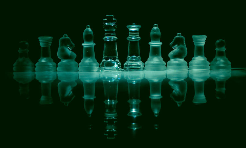 Close-up of chess pieces against black background