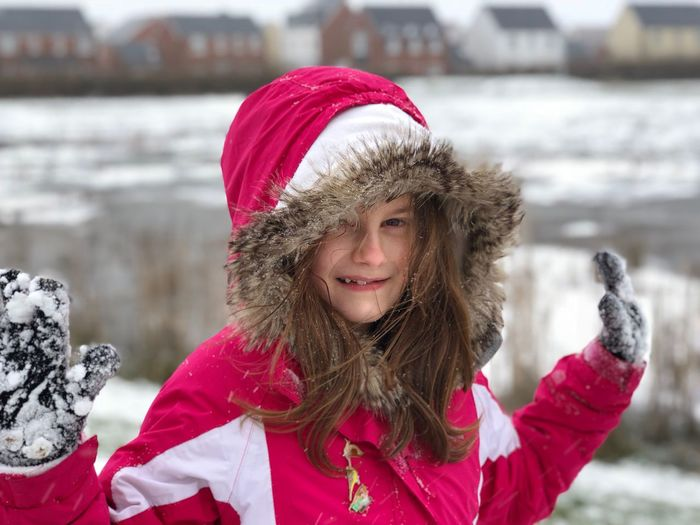 Portrait of girl wearing warm clothing during winter