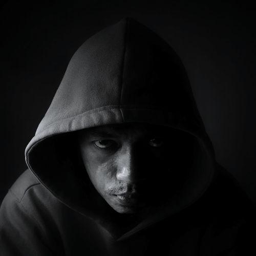 Close-Up Portrait Of Man Wearing Hood