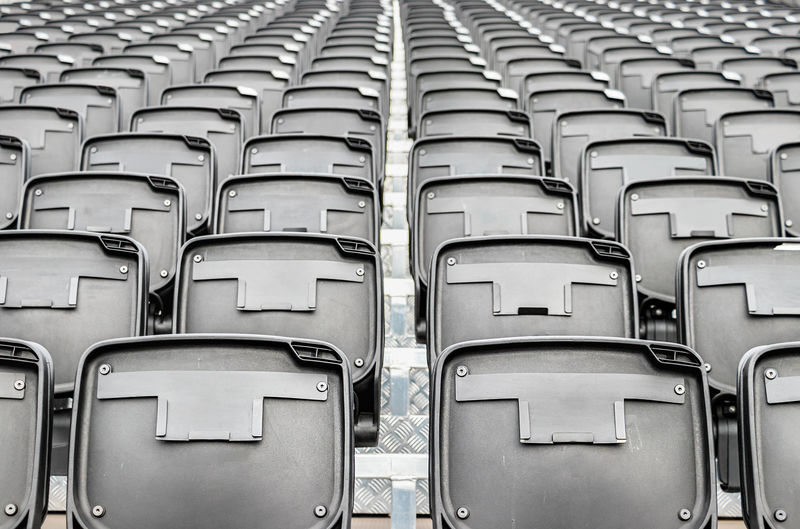Perspective view of folding plastic chairs at an outdoors cinema.