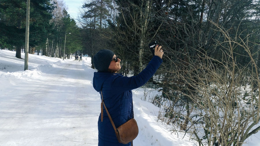 Side View Of Woman Photographing With Smart Phone