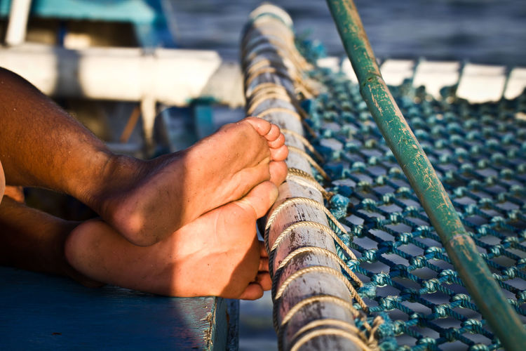 Adult Adults Only Boat Close-up Day Feet Fisherman Foot Human Body Part Human Foot Human Hand Human Leg Low Section Man Resting Man Sleeping One Man Only One Person Only Men Outdoors People EyeEm Selects