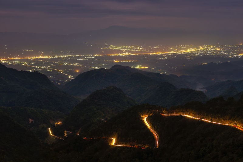 Tail light on the road up Ang khang. At dusk, from Mon Sone View Point, Chiang Mai Thailand, Long Exposure. Beauty In Nature Illuminated Landscape Mountain Mountain Range Nature Night No People Outdoors Raod Scenics Sky Sunset Tail Light Tranquil Scene Tranquility Way
