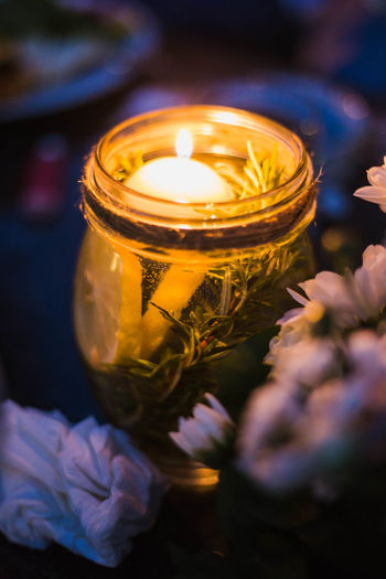 Close-up of illuminated tea light candles on flower
