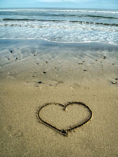 Heart shape on sand at beach