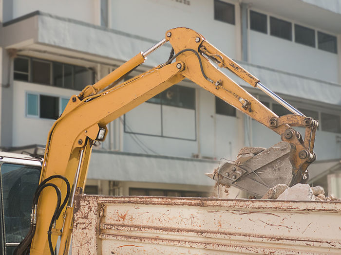 Low angle view of machinery against building