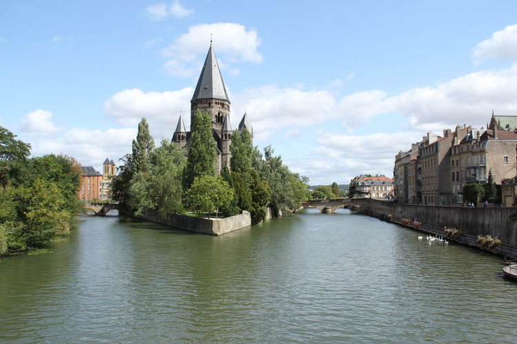 Church on the River in city center of Metz, France. Architecture Bridges Castle Cathedral Center Church City Faith Travel View Blue Sky Building Canal Europe Germany Historic House Landmark Religion River Sky Tourism Tower Town Water