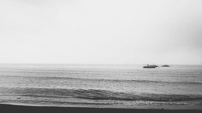 """ hard rain [ bali disappear ] :) Hard Rain Watching Boats Black And White EyeEm Bnw EyeEm Indonesia Beach Photography Being A Beach Bum Life Is A Beach On The Beach Banyuwangi"