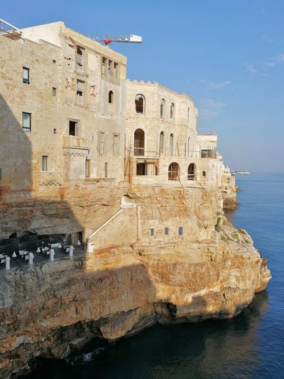 Architecture Built Structure Building Exterior Water Sky History The Past Sea Nature Building Travel Travel Destinations Day No People Tourism Outdoors Waterfront Fort City Grotta Palazzese Borgo Centro Storico Scogliera Alba Mattina Presto