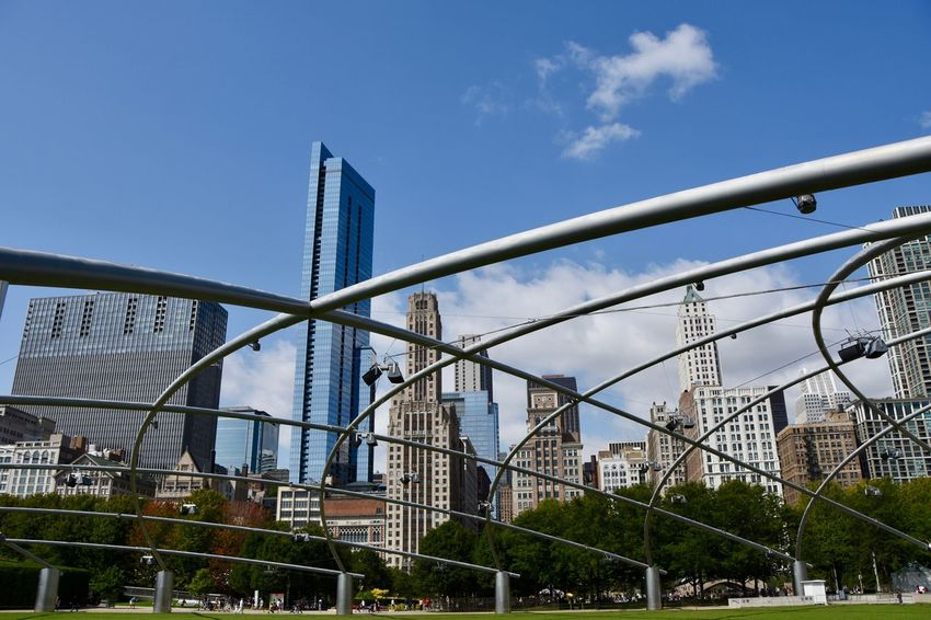 Architecture Power Skyline Urban Geometry American Culture Architecture Building Exterior Built Structure Business Finance And Industry City Corporate Business Day Energetic Geometric Shape Low Angle View Modern No People Office Building Exterior Outdoors Park - Man Made Space Sky Skyscraper Summer Symmetry Tree