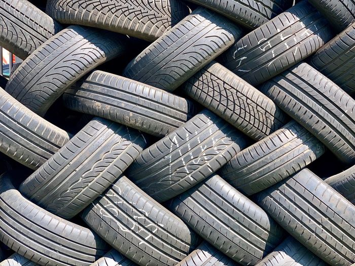 Full Frame Backgrounds No People Large Group Of Objects Abundance Stack Pattern Textured  Rubber Still Life Tire Day Close-up Wheel High Angle View Repetition Outdoors Arrangement Sunlight Gray