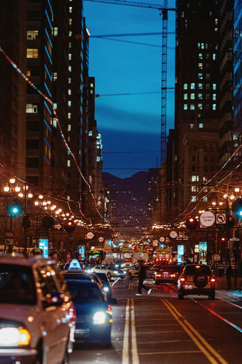 Traffic on city street and buildings at night