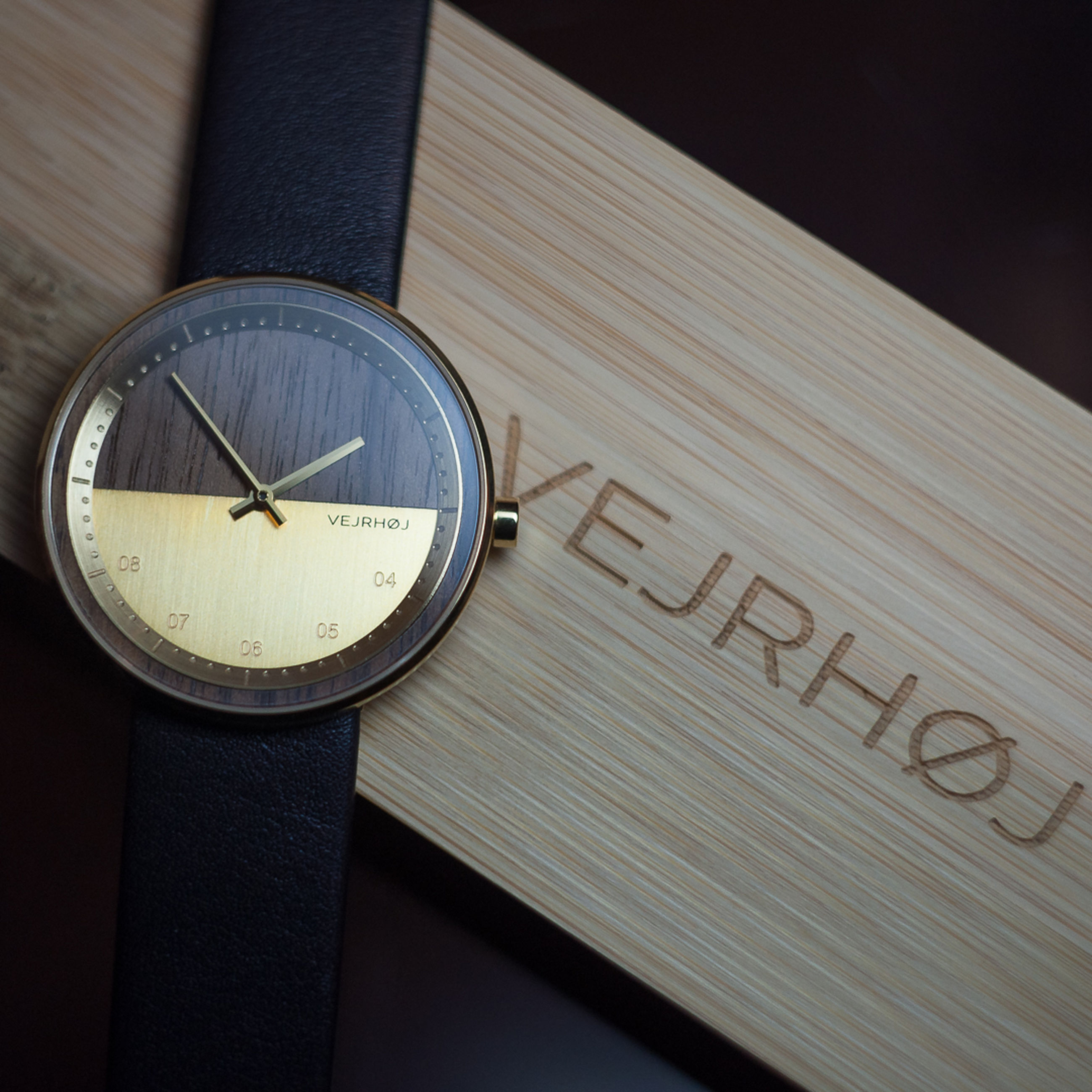 text, communication, indoors, western script, no people, table, time, close-up, still life, number, clock, high angle view, sign, publication, book, information, accuracy, wood - material, technology, personal accessory, message