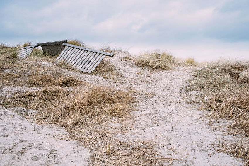 Beach Built Structure Cold Temperature Day Grass Landscape Nature No People Outdoors Sand Sand Dune Sky