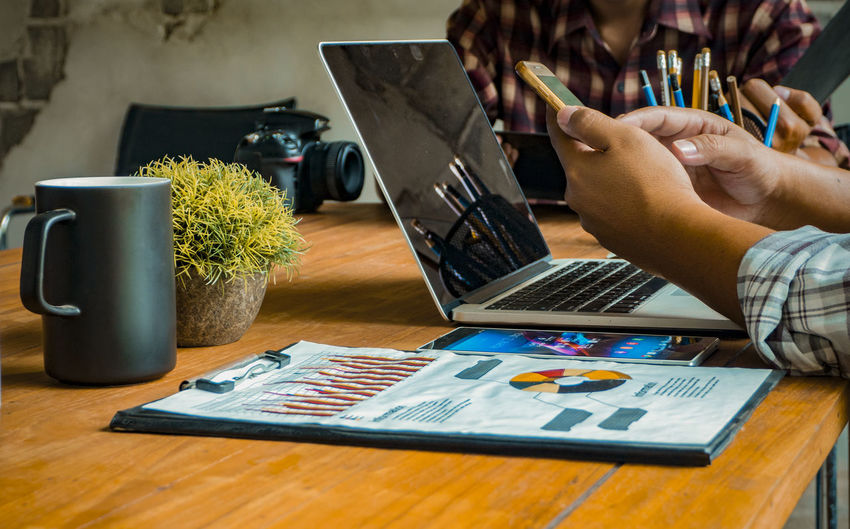 Common work practices Concept. Using Laptop Communication Wireless Technology Technology Computer Real People Laptop Connection Internet Business