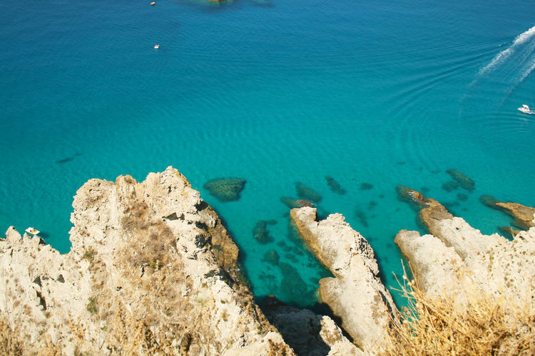 High angle view of rocks in sea at capo vaticano