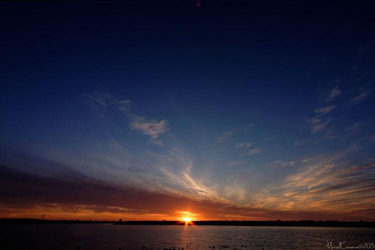 Atmosphere Atmospheric Mood Cloud Cloud - Sky Cloudscape Cloudy Distant Dramatic Sky Dusk Glowing Light Majestic Moody Sky Orange Color Outdoors Silhouette Sky Storm Cloud Sun Sunset