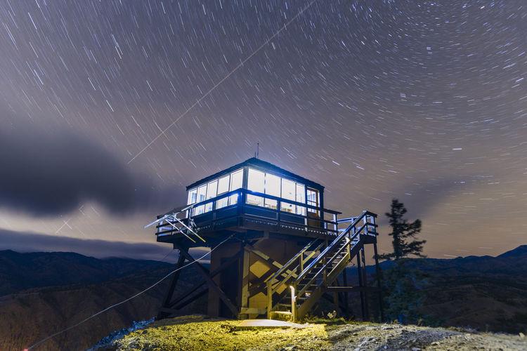 Ferris wheel against sky at night