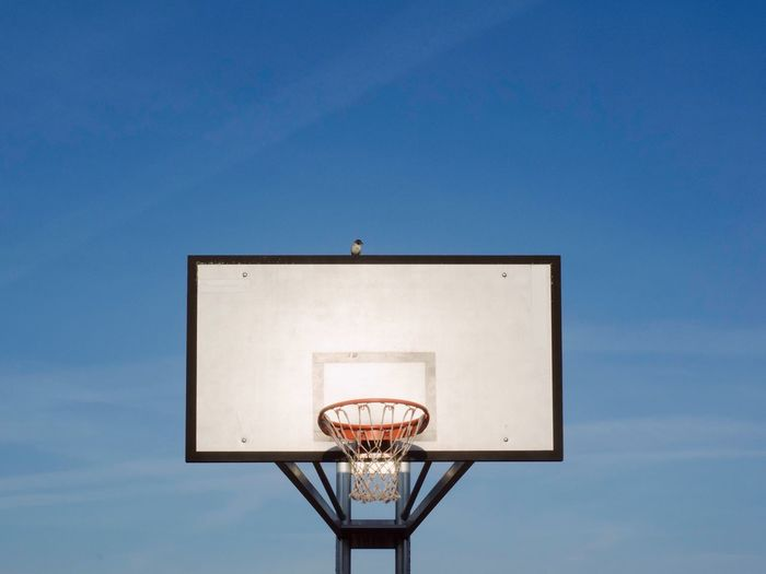 Basketball Sport Equipment Sport Basketball Hoop Basketball - Sport Low Angle View Blue Sky Sport No People Net - Sports Equipment Architecture Nature Outdoors Copy Space Clear Sky Built Structure Lighting Equipment Sunlight Building Exterior